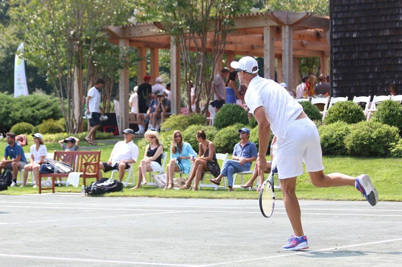 tennis player serving tennis ball